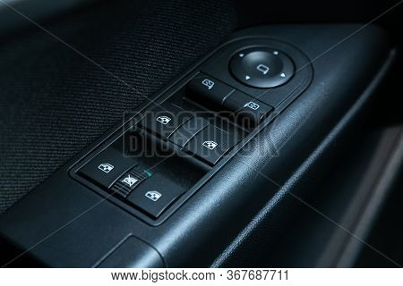 Novosibirsk/ Russia - May 03 2020:  Opel Astra, Close-up Of The Side Door Buttons: Window Adjustment