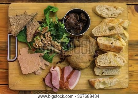 Gourmet French Platter With Duck Pate, Foie Gras, Duck Confit And Seared Duck Breast With Baguette A