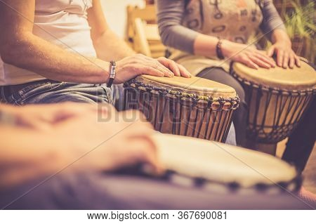 Close Up Of Hands On African Drums, Drumming For A Music Therapy, Therapy By Drums