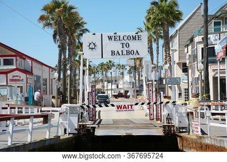 5-20-2020 Balboa Island, CA. USA: Balboa Island Ferry crossing carrying cars across the channel to Newport Beach CA. Editorial.