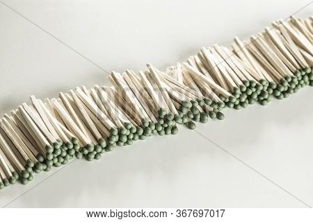Heap Of Matches With Green Heads On A White Background