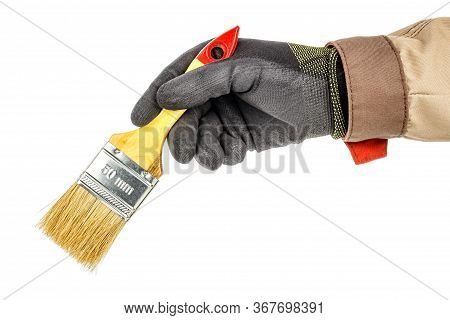 Man Hand In Black Protective Glove And Brown Uniform Holds Unused Construction Paintbrush Isolated O