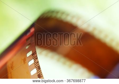 Color Negative Film In Blur. 35mm Negative Film. Photographic Film View With Shallow Depth Of Field.