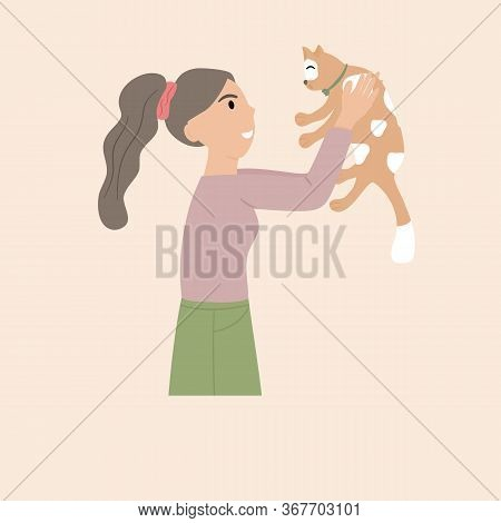 Pet Owner Isolated On Soft Tone Background. Woman Holds The Cute Cat In The Chest Warmly.  Portrait