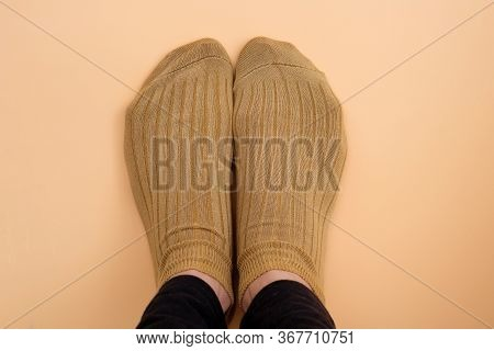 Socks Light Brown On Legs Top View. Short Knitted Socks For Sports On Women's Feet. Soft Comfortable