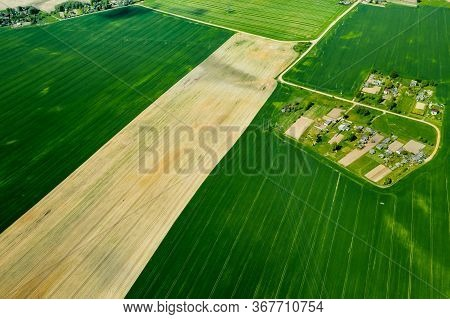 Top View Of A Sown Green Field And A Small Village In Belarus. Agricultural Fields In The Village.sp
