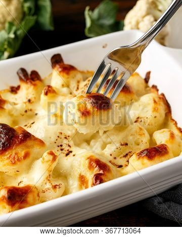 Oven Baked Cauliflower Cheese With Bechamel Sauce In White Ceramic Baking Tray