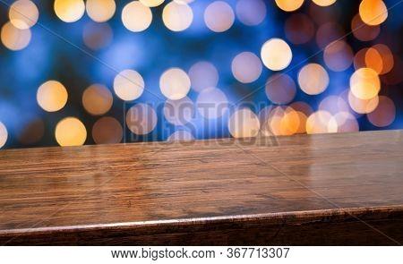 Empty Diagonal Dark Wood Table With Blur Night Lights In Blue Sky Bokeh Background,banner Mockup Tem