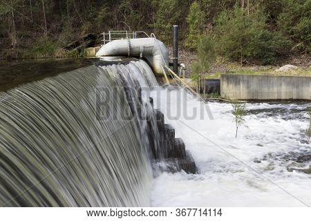 A Weir Overflowing In A Small Country Town In Australia.
