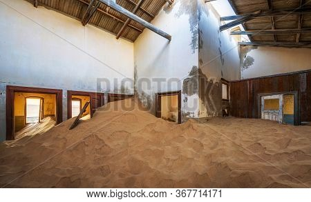 Ruins Of A House Filled With Desert Sand In The Mining Town Kolmanskop Located In The Namib Desert N