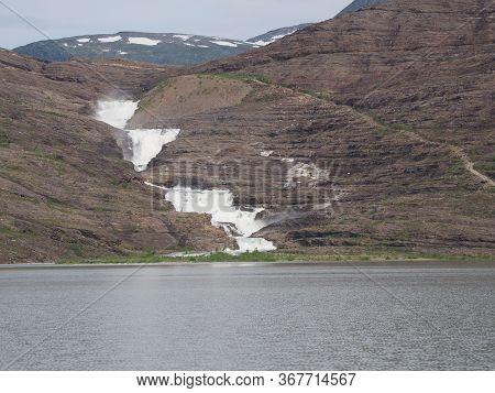 Svartisvatnet Lake And Waterfall View Near European Svartisen Glacier In Nordland County In Norway,