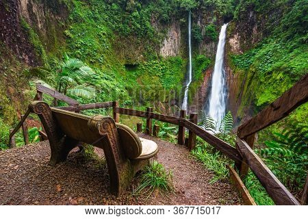 Empty Bench At The Catarata Del Toro Waterfall In Costa Rica. This Waterfall Is Located In Juan Cast