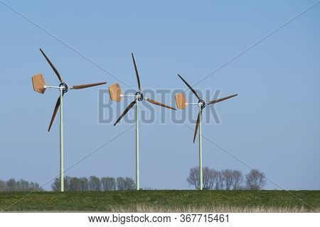 Groningen, The Netherlands - April 29 2020: Small Wind Turbines With Wooden Blades Of Eaz Twelve Win
