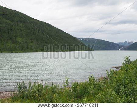 Mountain Range And Shore Of Svartisvatnet Lake Landscapes Near European Svartisen Glacier In Nordlan