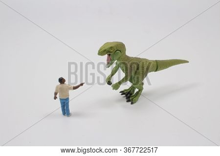 A Timy Figure Man Fight The Dinosaur Toy