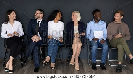 Happy Diverse Business People Sitting In Row, Waiting For Interview