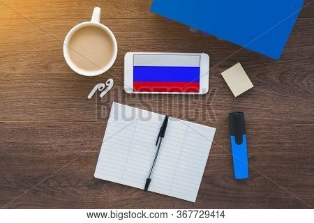 Russia Flag, Notebook, Student, Smartphone And Wireless Headphones On A Wooden Desktop, Concept Of L
