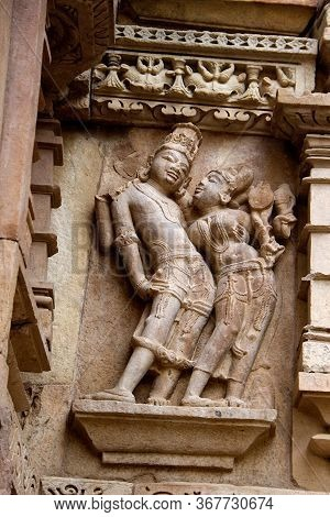 Sculpture Of Charming Couple On Wall At Jain Temple In Khajuraho, Madhya Pradesh, India, Asia
