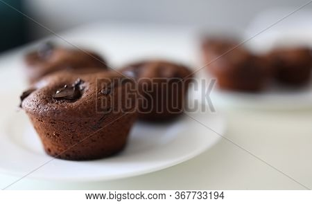 Close-up Of Tasty Dessert For Tea Or Coffee. Chocolate Brownies With Cocoa Stuffing On White Plate.