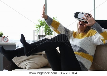 Girl Couch Emotionally Reacts With Virtual Glasses. Funny Entertainment At Home During Self-isolatio