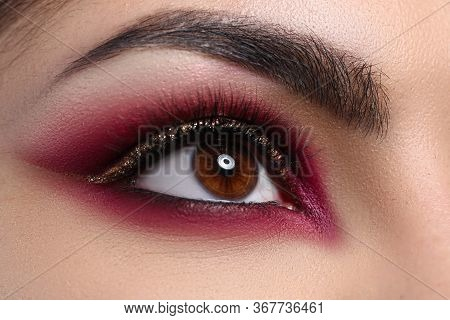 Close-up Beautiful Female Eye Decorated With Makeup. Quarantine Makeup Training. Make-up Option That