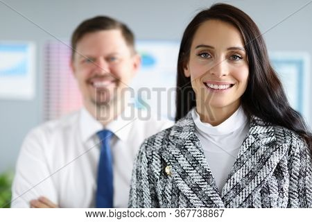 Smiling Employees Man And Woman Stand In Office. Creating Favorable Psychological Climate In Team. S