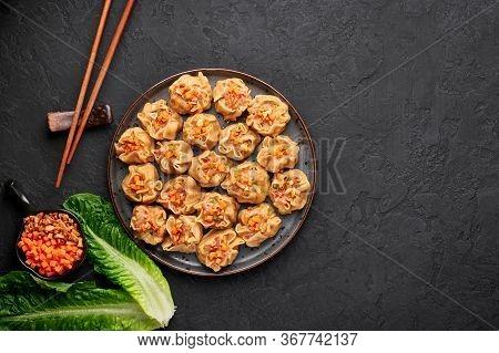 Shumai Or Kanom Jeeb Or Steamed Pork And Shrimp Dumplings On A Black Plate On Dark Slate Backdrop. S