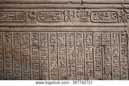 Ancient Hieroglyph And Relief On The Wall Of A Temple In Egypt