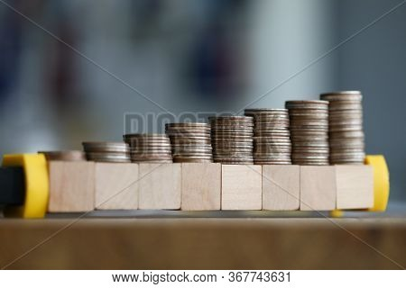 Close-up Table Are Coins Growing In Wooden Blocks. Accumulation Funds. To Encourage Fundraising. Acc