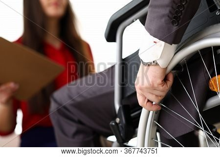 Man In Suit On Wheelchair Communicates With Woman. Prestigious Job For People With Disabilities. Off