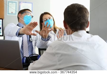 Patients Look At Scared Doctors In Respirators. Quarantine In Clinic. Violation Quarantine Rules Dur