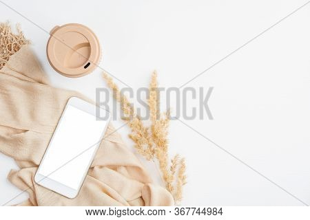 Elegant Home Office Desk Table With Beige Blanket, Smartphone With Blank Screen Mockup, Cup Of Coffe