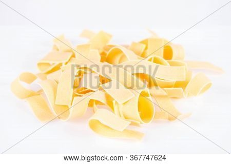 Raw Pappardelle Pasta On A White Background