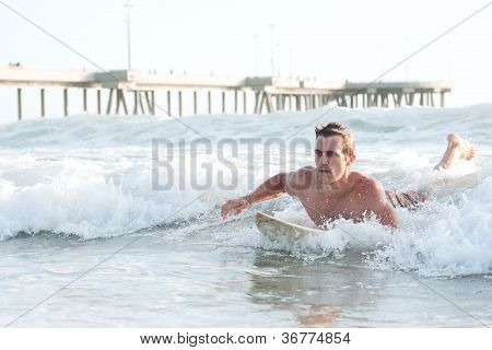Active Young Man Surfing In The Ocean