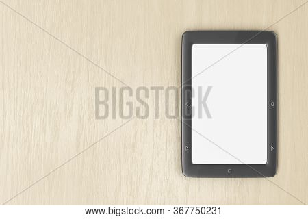 E-book Reader With Blank Display On Wood Desk, Top View. 3d Illustration