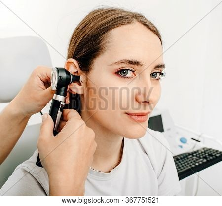 Hearing Exam For A Woman. Diagnosis Of Impairment And Hearing Testing In Adults. Patient Woman Durin