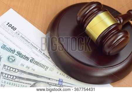 Justice Mallet And 1040 Irs U.s. Individual Income Tax Return Form And Refund Check From United Stat