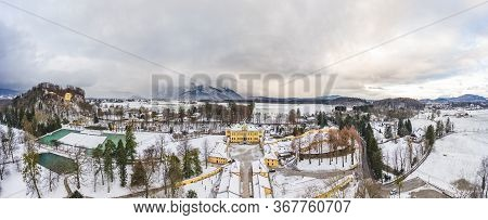 Panoramic Aerial View Of Schloss Hellbrunn Covered In Snow With View Of Untersberg Near Salzburg Out