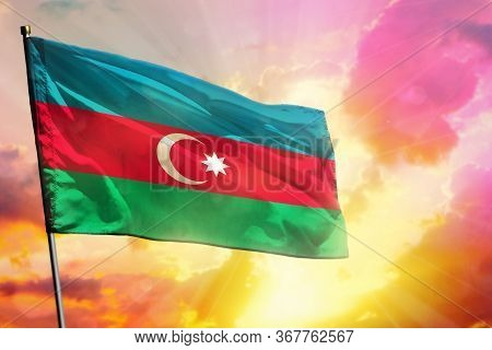 Fluttering Azerbaijan Flag On Beautiful Colorful Sunset Or Sunrise Background. Azerbaijan Success An