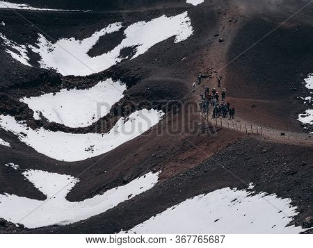A Group Of Tourists On The Slope Of Mount Etna.