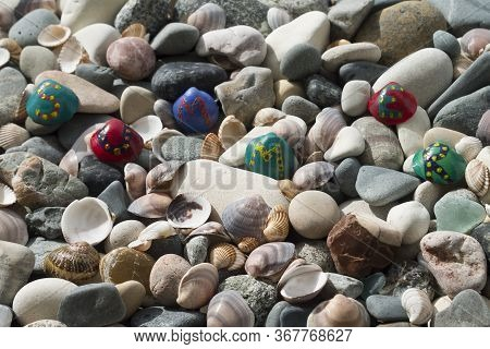 Beach Stones And Seashell Background With Bright Painted Seashells With Letters Forming Word Summer