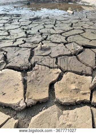 The Dry Land At Dry Season It Is Waterless And Hot Weather Climate.