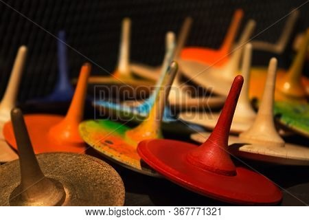 Closeup View Of Colorful Handmade Painted Wooden Toys - Peg Tops Or Whirligigs As Creative Backgroun