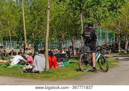 Montreal, Canada - 23 May 2020: Police Patrol Laurier Park To Enforce The Coronavirus Physical-dista