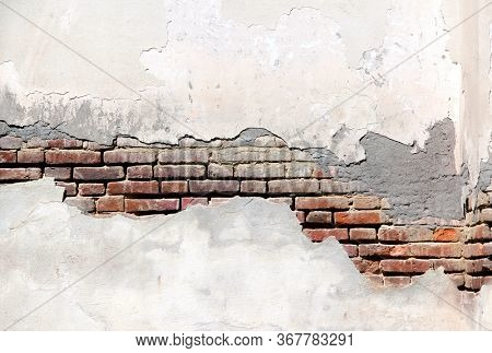 Grunge background with texture of old brick wall and cracked stucco of white color. Copy space for text