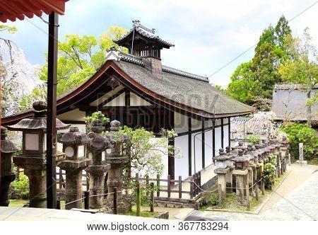 Ancient pavilion and old stone japanese lanterns at Kasuga Grand Shrine (Kasuga-Taisha Shrine), Nara, Japan. UNESCO world heritage site. Spring sakura blossom season