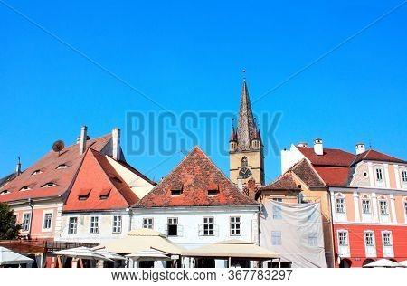 Medieval house and clock tower on Large Square (Piata Mare) in Sibiu, Transylvania, Romania