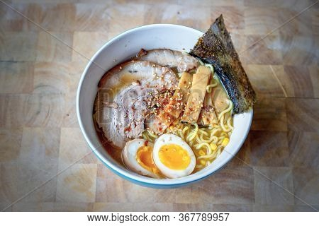 Close-up Of A Bowl Of Hokkaido Ramen In Rich Miso Soup Topped With Homemade Japanese Char Siu Or Jap