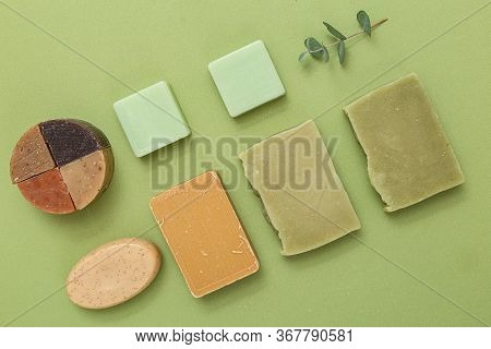 Natural Soap Of Different Shapes And A Sprig Of Eucalyptus On A Green Background. Undertone. Self-ca