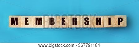 Membership Word On Wooden Cubes On Sky Blue Background. Business Concept